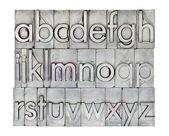English alphabet in metal type — Stock Photo