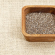 Chia seeds in wood bowl - Foto Stock