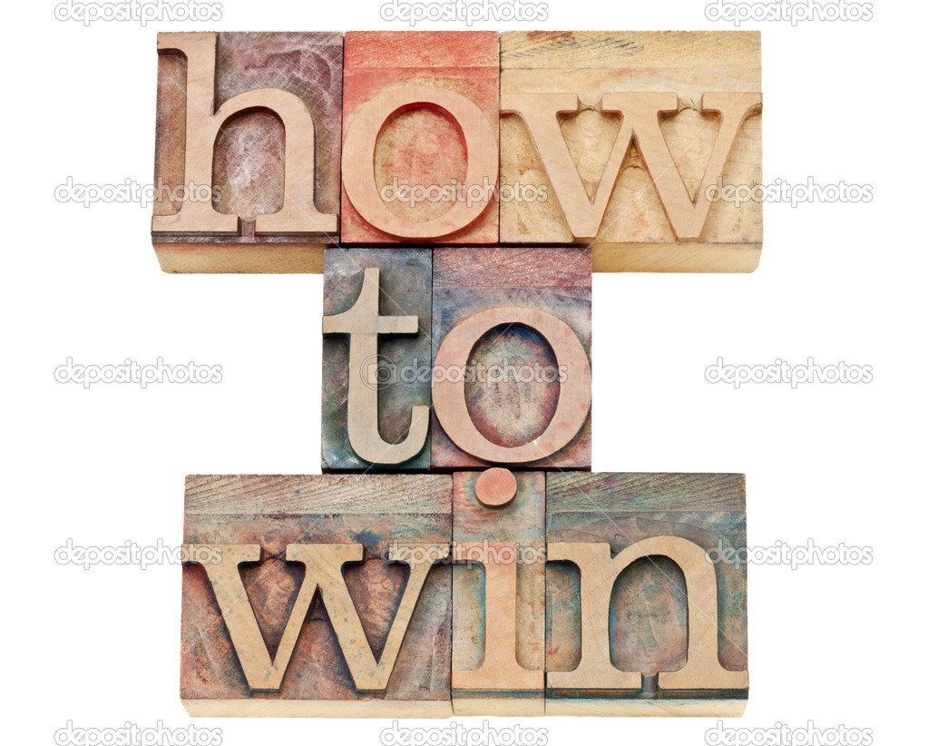 How to win - isolated text in vintage letterpress wood type stained by color inks  Stock Photo #12343103