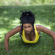 Young African American Woman Doing Pushups Outdoors — Stock Photo