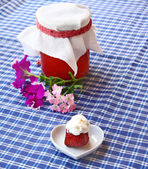 Strawberry with creams and jar of the strawberry cooking — Stock Photo