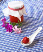 Strawberry and jar of the strawberry cooking — Stock Photo