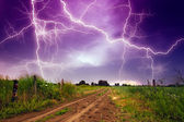 Rural road and lighting storm — Stock Photo