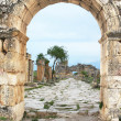 Stock Photo: Ruins of ancient city of Hierapolis on hill Pamukkale, T