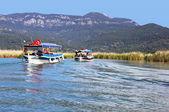 Pleasure boats motor up the Dalyan river, Turkey — Stock Photo