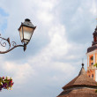 Stock Photo: Lantern and town hall in Kamianets-Podilskyi, Ukraine