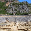 Ancient amphitheater and Lycian tombs in Myra, Turkey — Stock Photo
