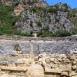 Ancient amphitheater and Lycian tombs in Myra, Turkey — Stock Photo #11410250