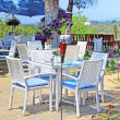 Cafe on the open air with white furniture - Stok fotoğraf