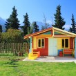 Children's play house in a yard - Stok fotoğraf