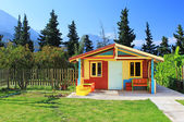 Children's play house in a yard — Stock Photo