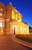 Night view of part of opera house in Odessa, Ukraine — Stock Photo