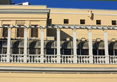 Yellow wall with balcony of an historic building — Stock Photo
