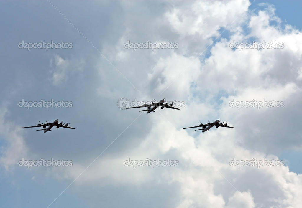 Three bombers TU-95 in a demonstration flight at the air show — Stock Photo #12278418