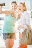Two woman taking a picture — Stock Photo