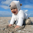 Little baby girl plays at the beach — Stock Photo