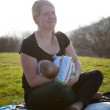 Mother breastfeeding here baby — Stock Photo