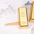 Gold bars on graphs and statistics — Stock Photo #10796430