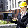 Female construction engineer show building — Stock Photo