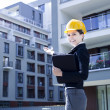 Female construction engineer show building — Stock Photo #11835623