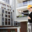 Female construction engineer show building — Stock Photo #11835630