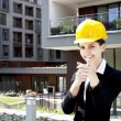 Female construction engineer show building — Stock Photo #11835639