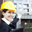 Female construction engineer show building — Stock Photo #11835658