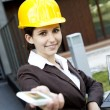 Young female construction engineer with phone — Stock Photo #11835725