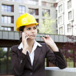Young female construction engineer with phone — Stock Photo #11835763