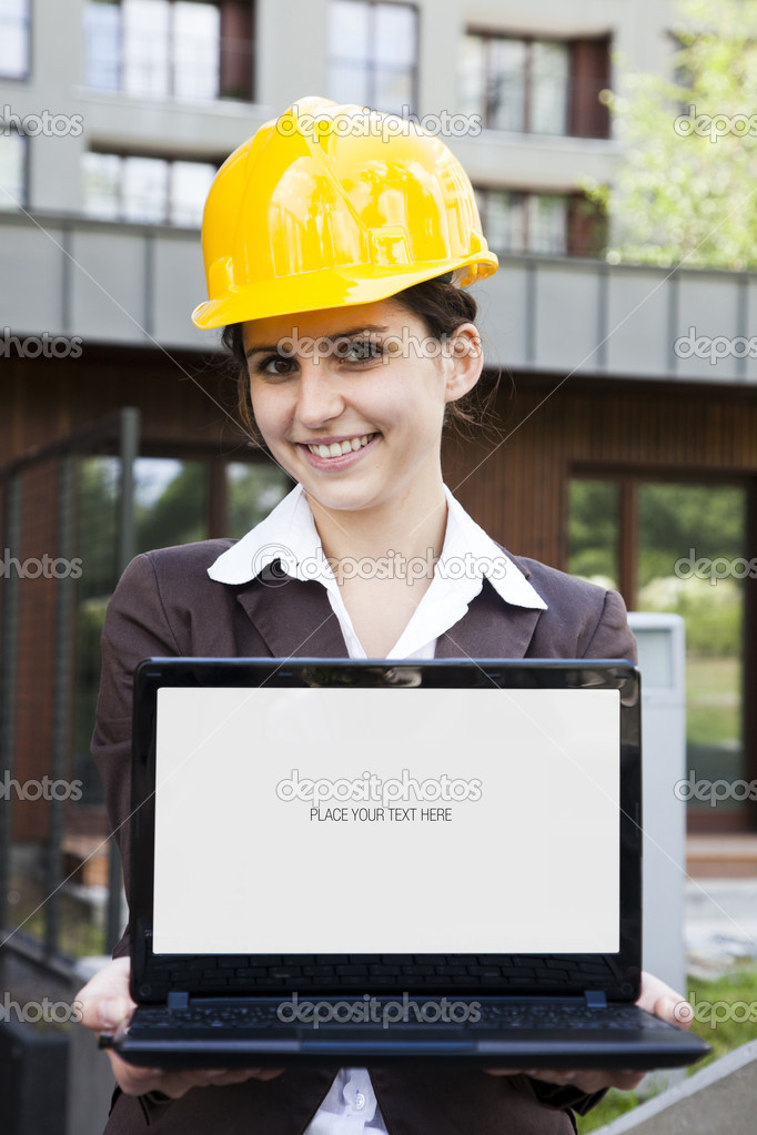 Female construction engineer and yellow helmet  Stock Photo #11835772