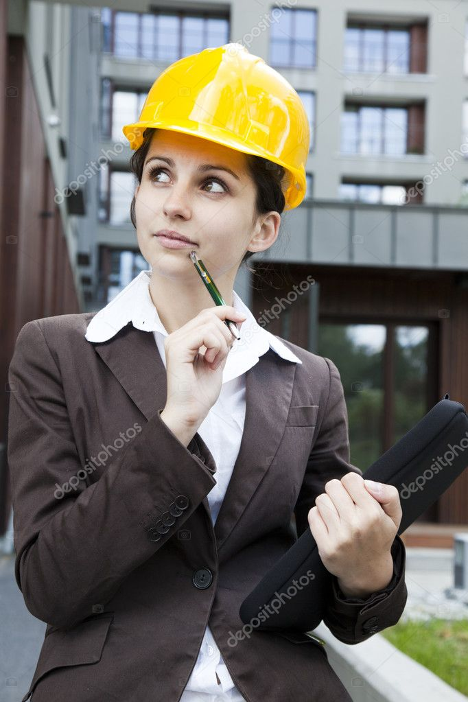 Female construction engineer and yellow helmet  Stock Photo #11835991