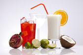 Exotic alcohol drinks set with fruits — Stock Photo