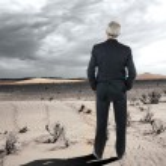 Businessman in the Desert — Stock Photo #11524354
