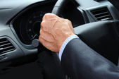 Man's Hand on Steering Wheel — Stock Photo