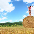 Woman enjoying on the wheat - Foto Stock
