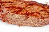 Juicy rib-eye beef steak — Stock Photo
