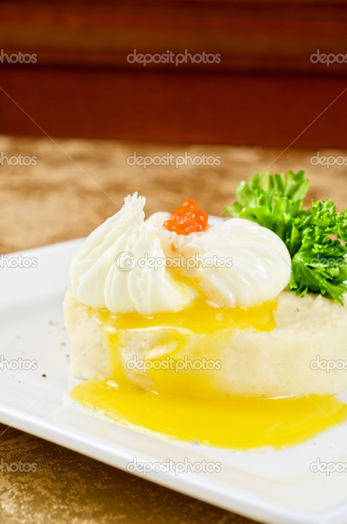 Poached eggs in a nest of mashed potatoes with greens and caviar  Stock Photo #11617187