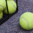Royalty-Free Stock Photo: Tennis Balls Behind Bars