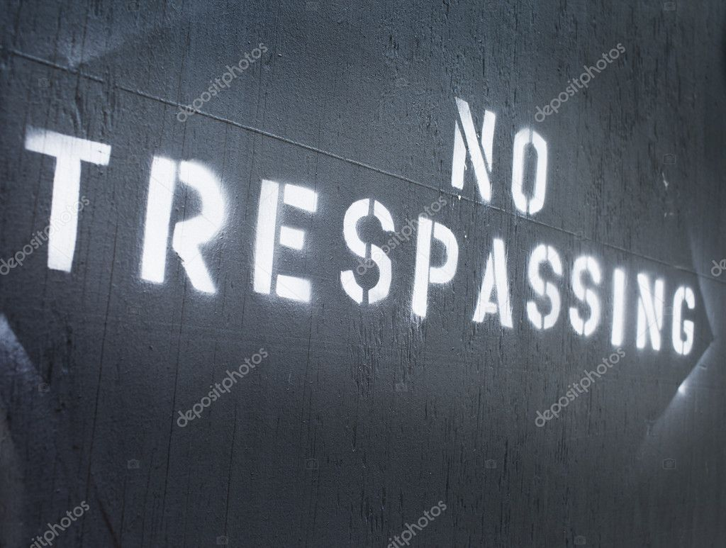 Text No Trespassing sprayed on a wall. — Stock Photo #11414629