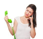 Young female getting stressed by someone on the phone. — Stock Photo