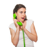 Young female talking on the phone — Stock Photo
