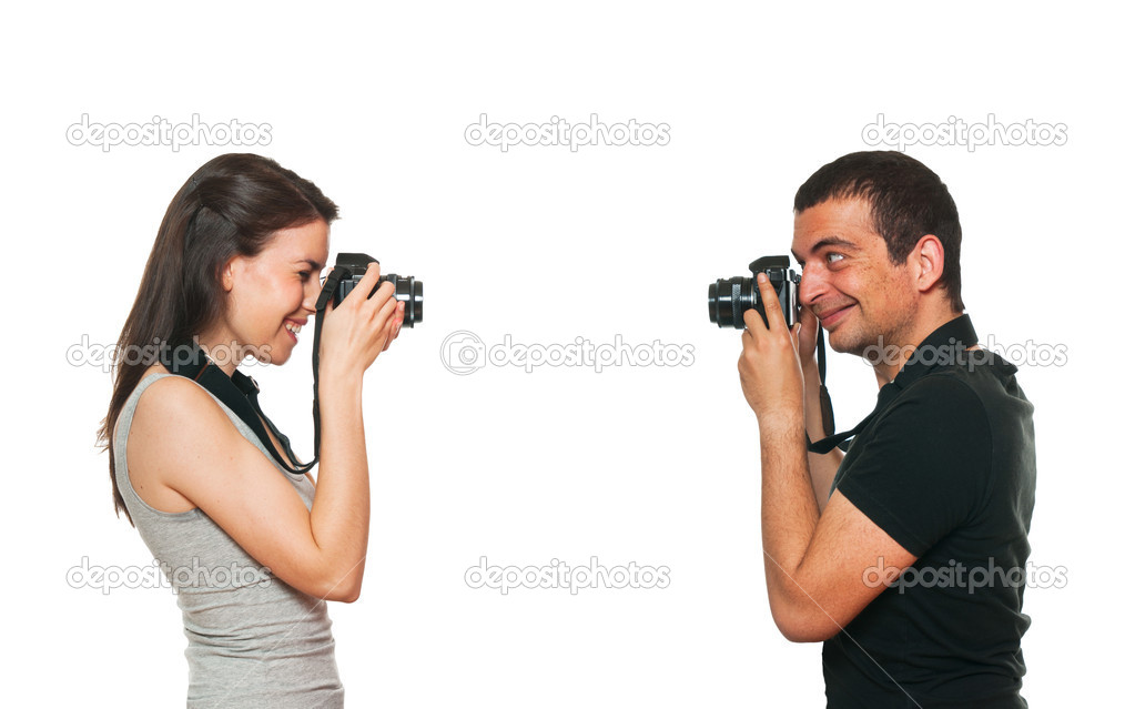 Young couple photographing themselves. Isolated on white — Stock Photo #11079586