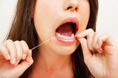 Portrait of a young woman flossing — Stock Photo