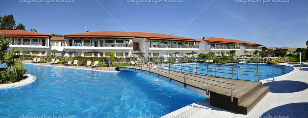 Picture of the hotel with swimming pool on foreground — Stock Photo #11596353