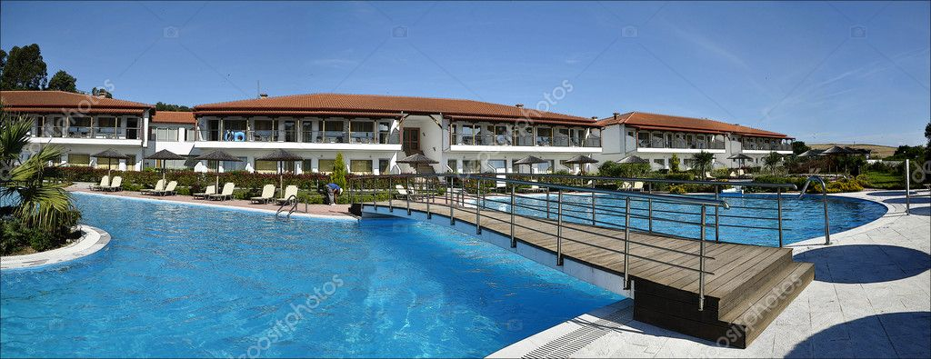 Picture of the hotel with swimming pool on foreground  Stock Photo #11596401