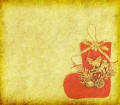 古い紙の上のクリスマスの靴下 — ストック写真