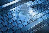 Technology earth globe against fiber optic background — Stock Photo