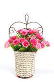 Basket of flowers isolated on white background — Stock Photo