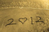 2012 new year message on the sand beach — Stock Photo