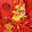 Chinese New Year Ornaments--Traditional Dancing Dragon,golden coin and Money Red Packet,red firecracker — Stock Photo #11660144